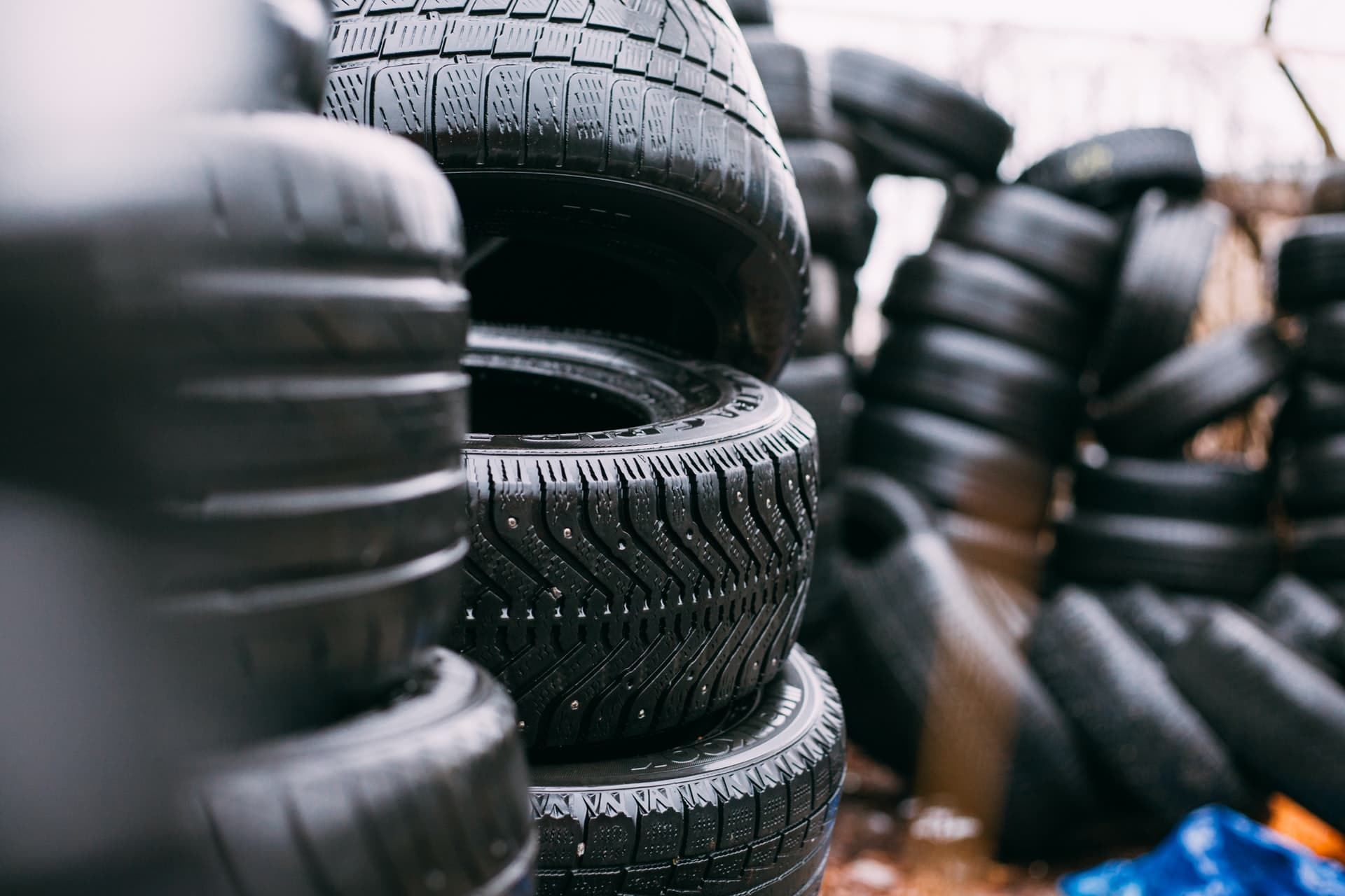 Piles of tires in a yard