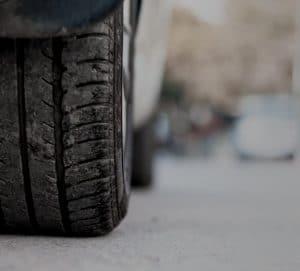 Closeup shot of worn tires on tarmac