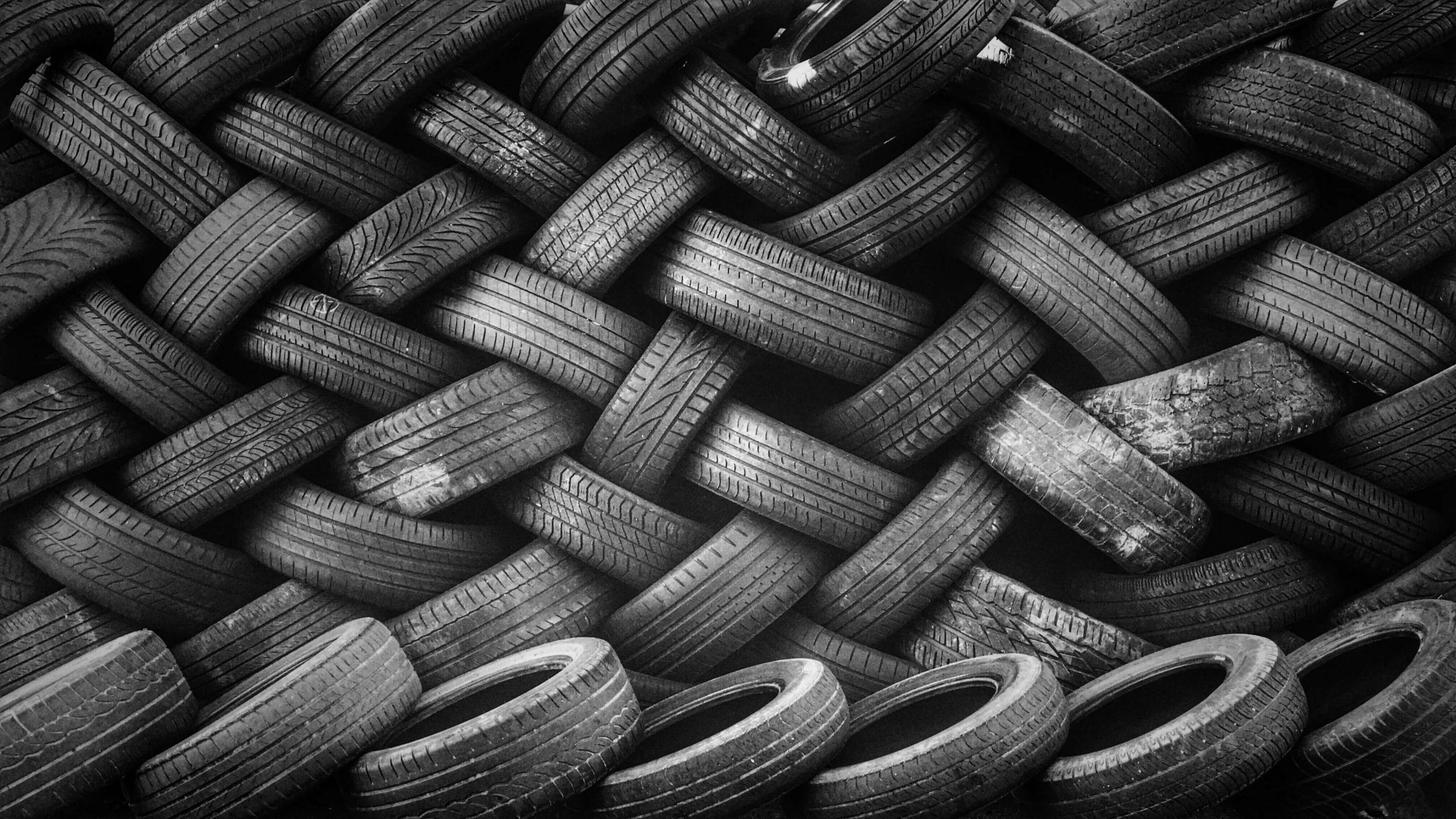 A bunch of tires stored in a zig-zag pattern