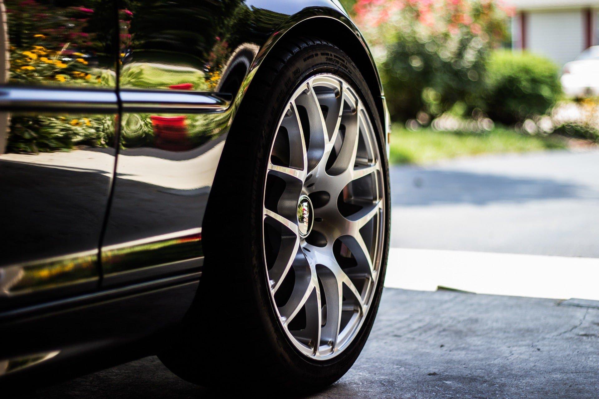 Closeup of a tire on a sleek, shiny car
