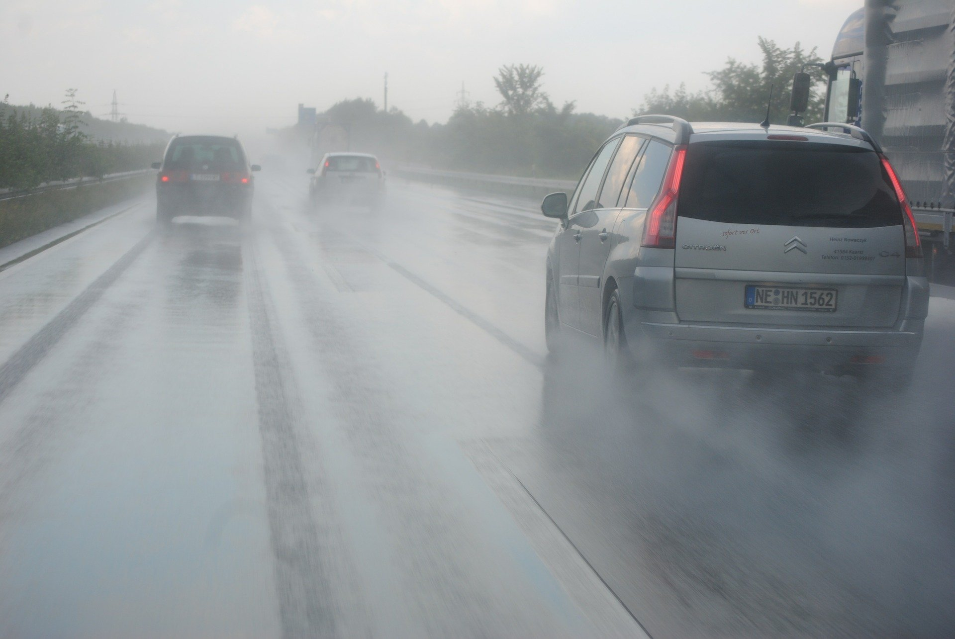 cars driving on the road during rains