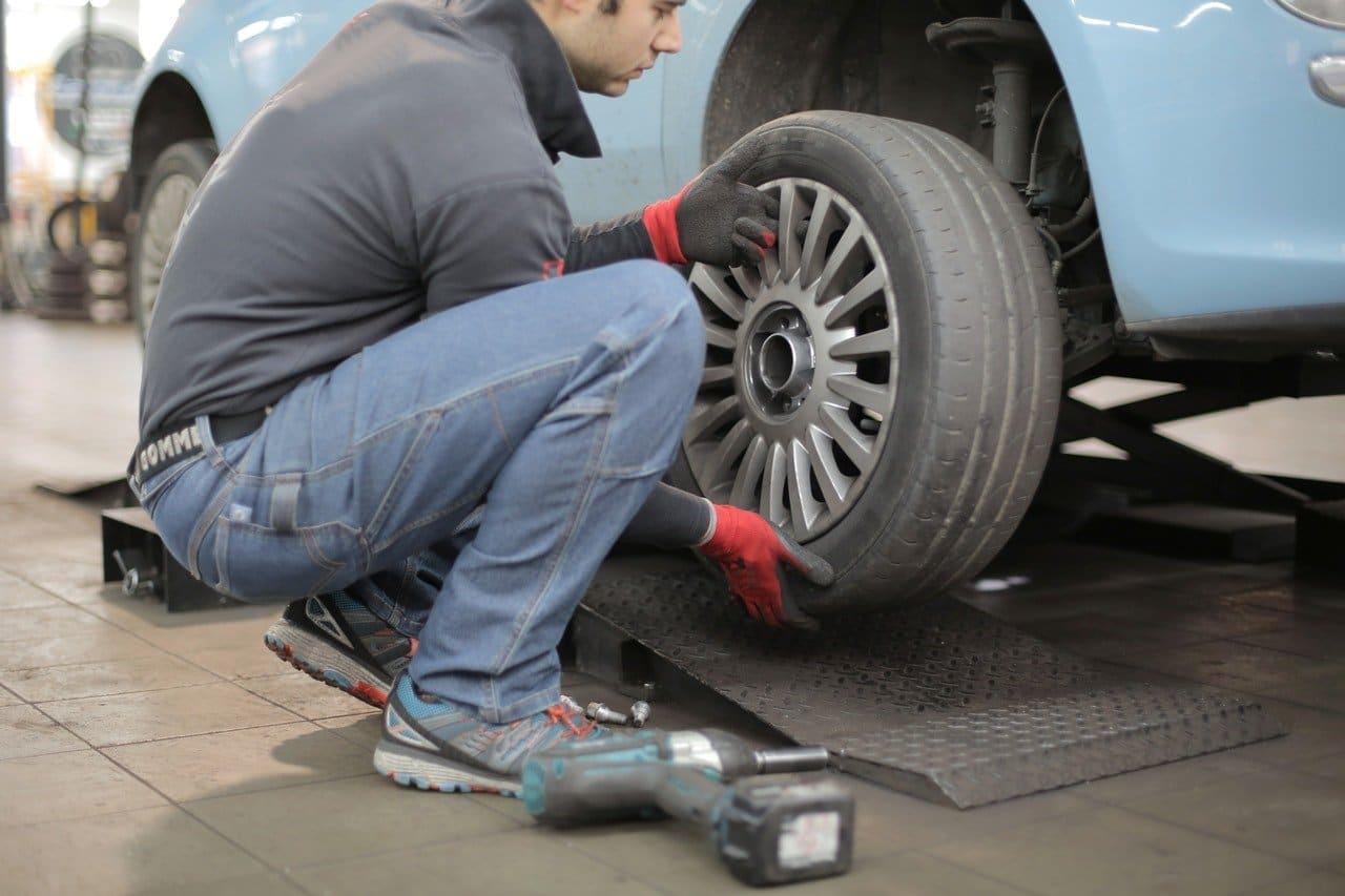 a guy sort his car tire